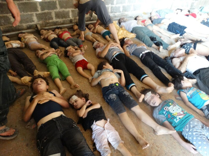 This image provided by Shaam News Network on Aug. 22, which has been authenticated based on its contents and other Associated Press reporting, purports to show bodies of victims of an attack on Ghouta, Syria, on Aug. 21.