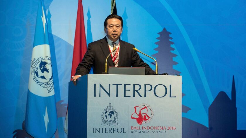 China's Vice Minister for Public Security Meng Hongwei delivers a speech at the 85th session of Interpol's general assembly Nov. 10 in Bali, Indonesia.