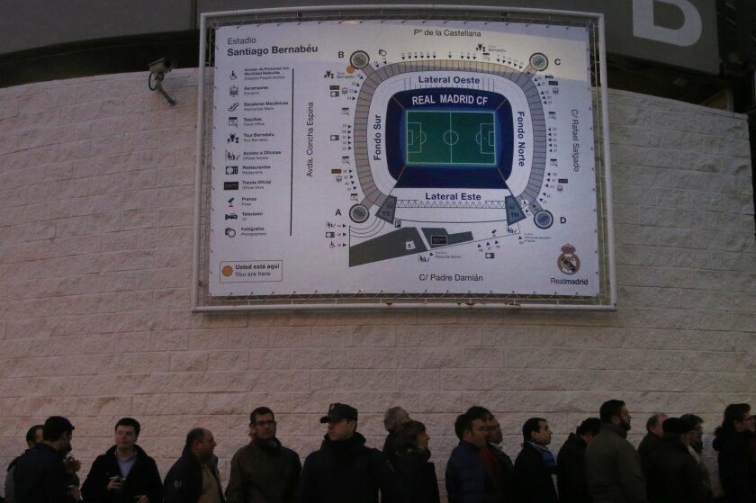 FILE - In this Nov. 21, 2015 file photo, fans queue to enter Real Madrid's Santiago Bernabeu stadium in Madrid, Spain for the first clasico of the season between Real Madrid and Barcelona. The rivalry between Real Madrid and Barcelona is heating up before a match in which Madrid isn't even playing.