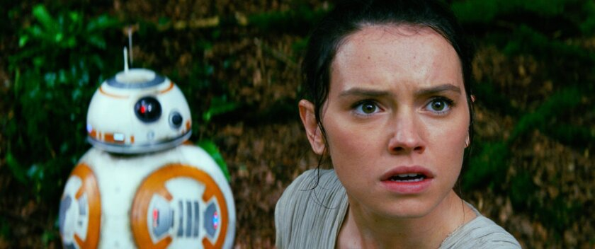 "Daisy Ridley, right, as Rey, and BB-8, in a scene from ""Star Wars: The Force Awakens."""