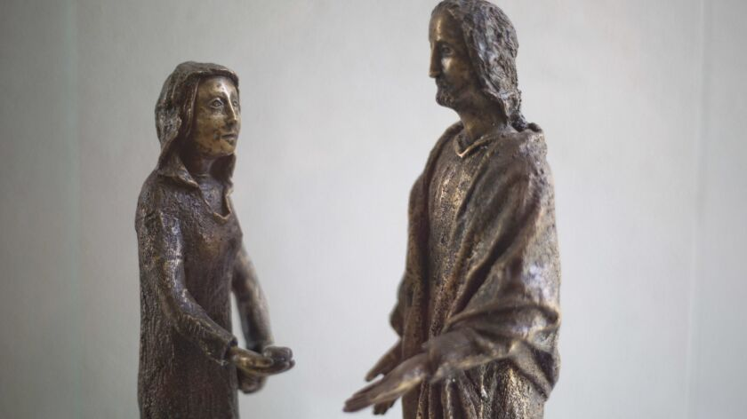 A sculpture of Mary Magdalene and Jesus on display at the Magdala center, on the Sea of Galilee in Migdal, Israel.