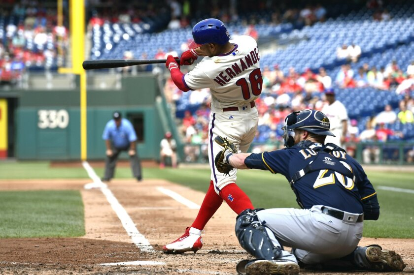 Philadelphia Phillies' Cesar Hernandez, front left, hits a two-run home run off Milwaukee Brewers starting pitcher Junior Guerra during the second inning of a baseball game, Saturday, June 4, 2016, in Philadelphia. (AP Photo/Derik Hamilton)