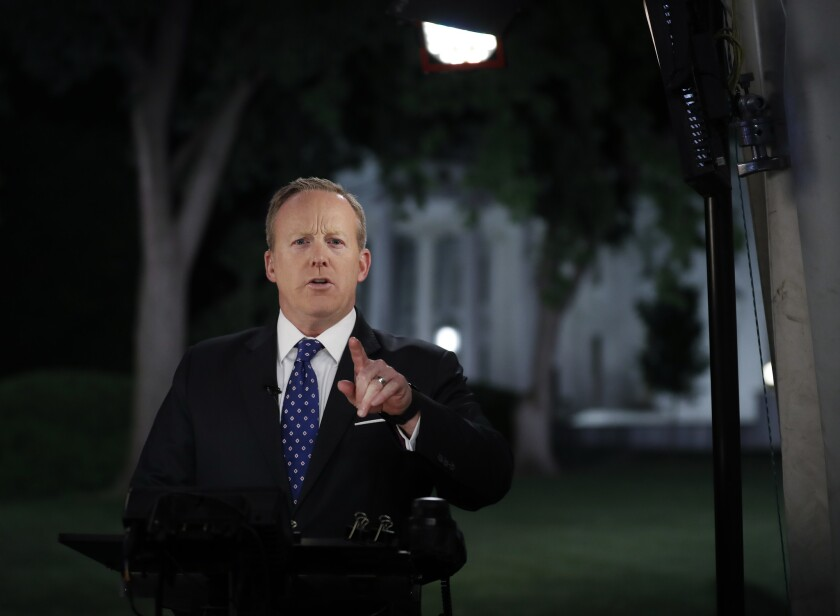 White House Press Secretary Sean Spicer talks to reporters near the White House.