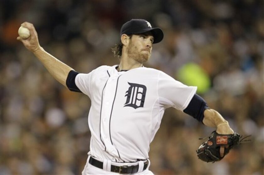 Detroit Tigers starting pitcher Doug Fister (58) throws during the first inning of Game 3 of baseball's American League championship series against the Texas Rangers, Tuesday, Oct. 11, 2011, in Detroit. (AP Photo/Paul Sancya)