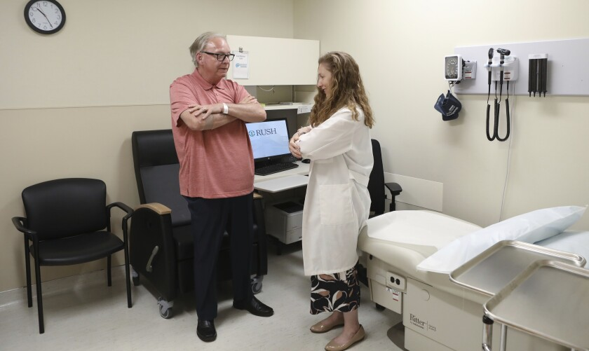Dr. Jori Fleisher, a neurologist, examines Thomas Doyle, who hopes blood tests may someday replace the invasive diagnostic testing he endured to be diagnosed with Lewy body dementia.