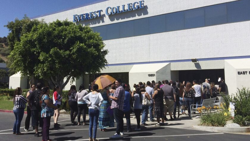 Students wait outside Everest College in the City of Industry in 2015 after Everest's parent company, Corinthian Colleges, shut down its campuses.
