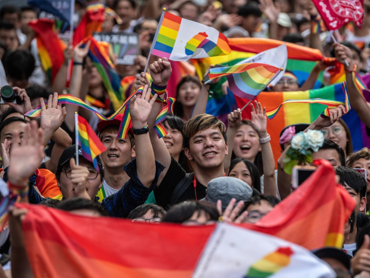 People celebrate after Taiwan's parliament voted to legalise same-sex marriage in Taipei, Taiwan.