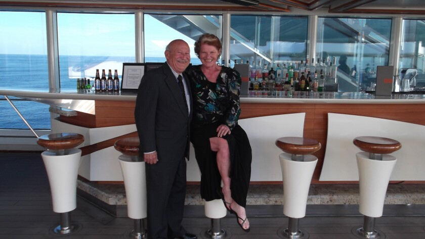 Marie Falcon and her husband Rene pose on a cruise ship off the coast of France last March 2020