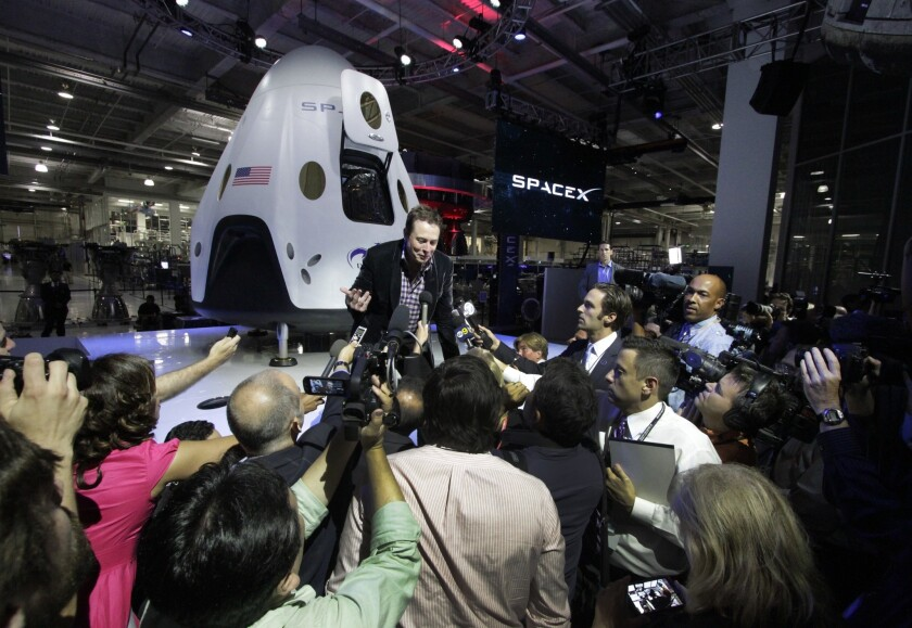 "SpaceX Chief Executive Elon Musk responds to the media Thursday evening after introducing the Dragon V2 capsule. ""We wanted to take a big step in technology,"" Musk says. ""It really takes things to the next level."""