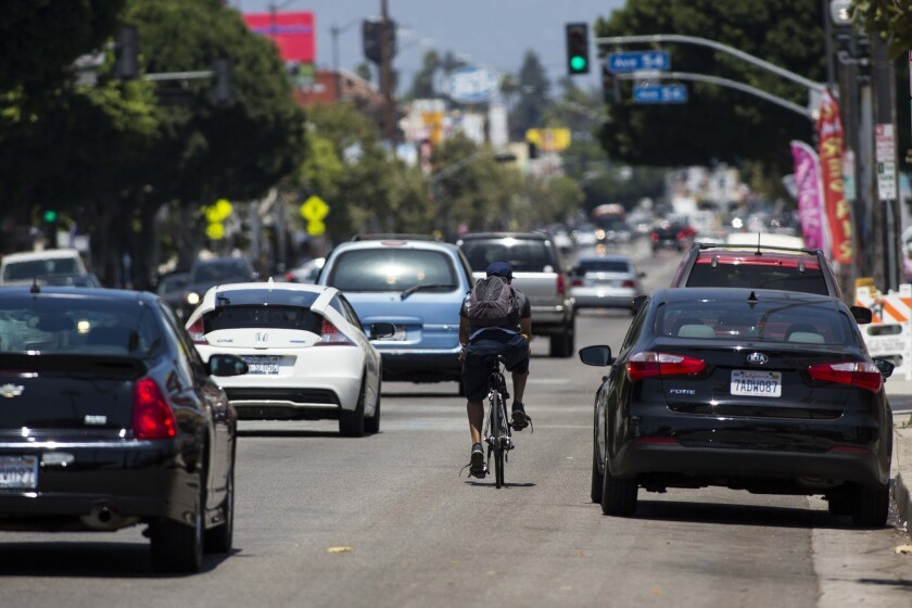 A cyclist bikes up North Figueroa Street between Avenue 52 and Avenue 56 in Highland Park on July 16, 2014.
