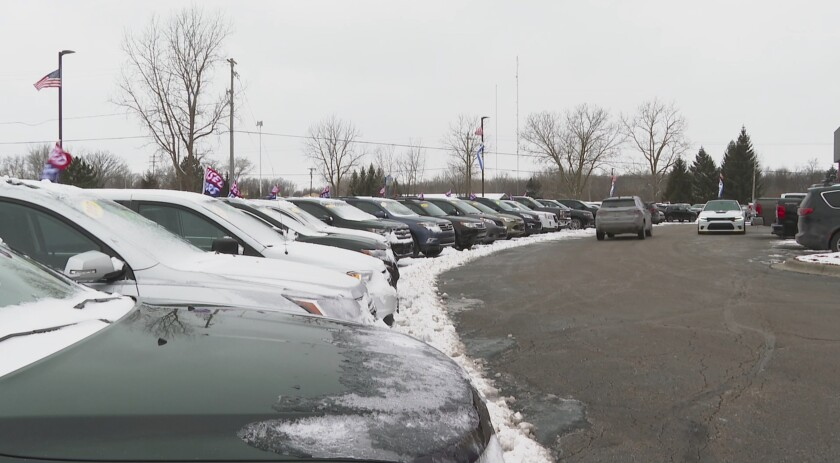 In this image made from video, cars drive through the used vehicle lot at a LaFontaine auto dealership in Fenton Township, Mich., Thursday, Jan. 28, 2021. A chain reaction touched off by the coronavirus pandemic has pushed new-vehicle prices to record highs and dramatically driven up the cost of used ones. (AP Photo/Mike Householder)