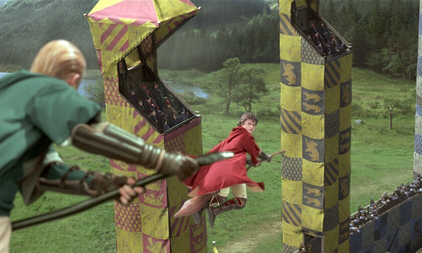 """The """"Harry Potter"""" books and movies introduced the fictional sport of Quidditch, here played by Draco Malfoy (Tom Felton), left, and Harry Potter (Daniel Radcliffe) in """"Harry Potter and the Chamber of Secrets."""""""