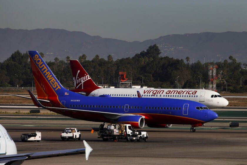 Southwest and Virgin America planes at LAX