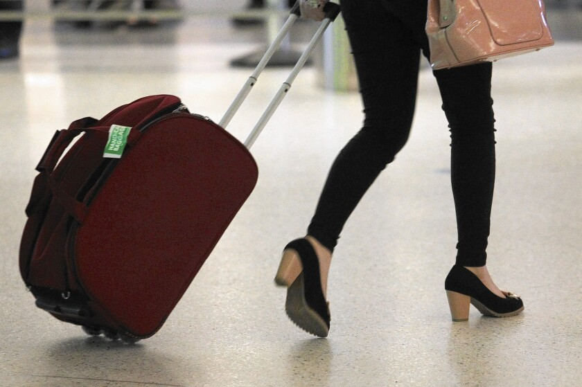 United Airlines Cracks Down On Oversized Carry On Bags Los Angeles Times,House Designs Pictures