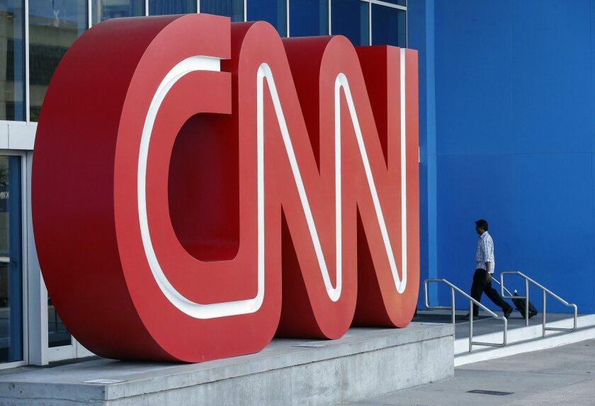 A man walks into the CNN Center in Atlanta on Aug. 26.