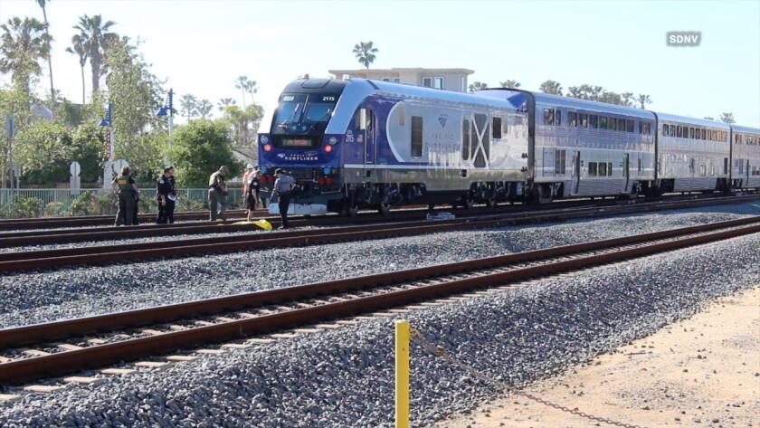 Sheriff's investigators probe a train-vs.-pedestrian crash Thursday in Oceanside.