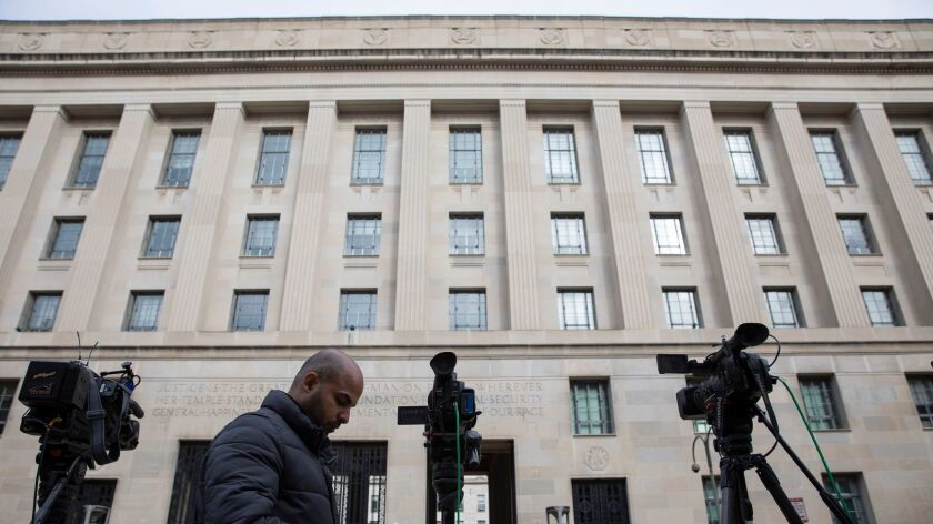 News crews gathered outside the Justice Department in March when Atty. Gen. William Barr released his summary of the Mueller report.