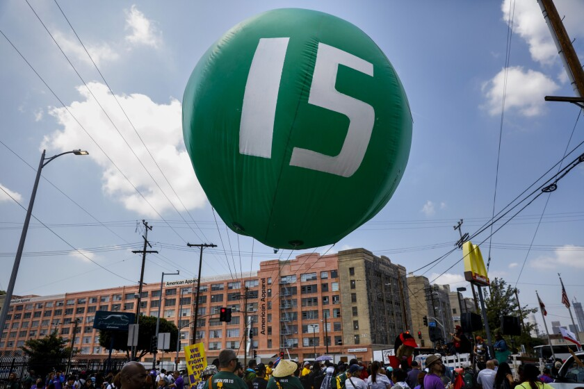 Workers march through downtown Los Angeles on April 14 to demand a nationwide $15-an-hour minimum wage.