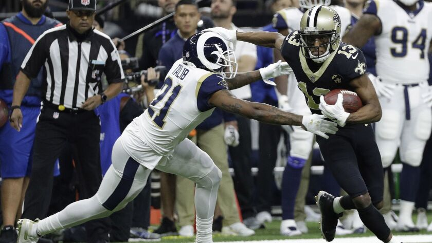 New Orleans Saints' Michael Thomas tries to get away from Los Angeles Rams' Aqib Talib during the first quarter.