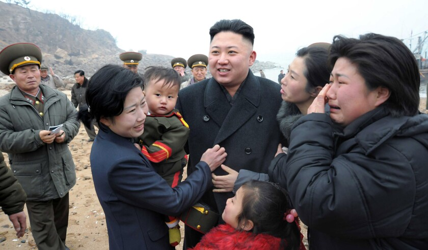 Kim Jong Un meets with the family of a soldier as he inspects the Jangjae Islet defense detachment on March 7, 2013.