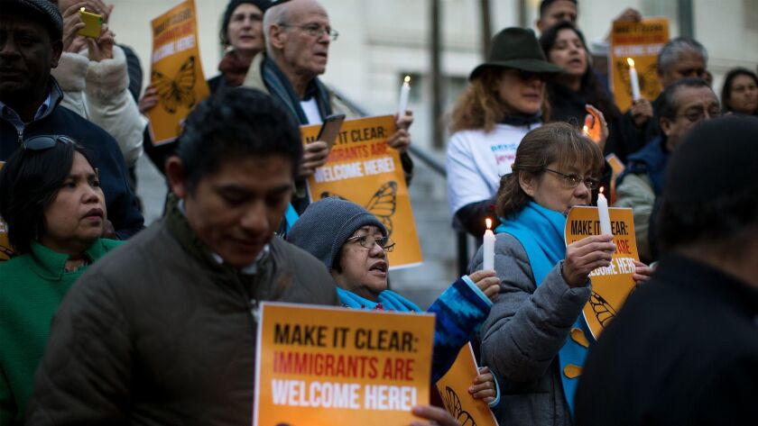 About 60 protesters attend a vigil at L.A. City Hall against Trump's actions on immigration.