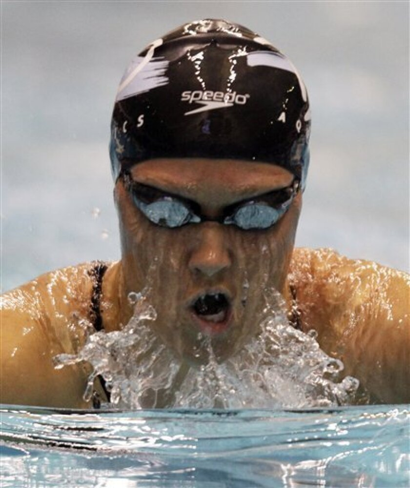 Elizabeth Pelton swims the breaststroke leg on her way to winning the women's 200-meter individual medley at the Indianapolis Grand Prix swimming meet in Indianapolis, Saturday, March 31, 2012.  (AP Photo/Michael Conroy)