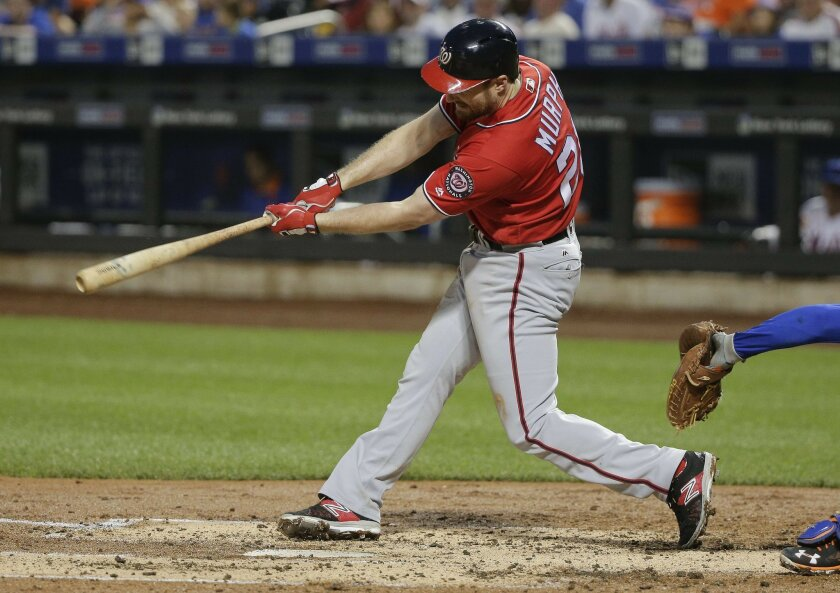Washington Nationals' Daniel Murphy singles to drive in Ben Revere during the third inning of a baseball game against the New York Mets, Saturday, July 9, 2016, in New York. (AP Photo/Julie Jacobson)