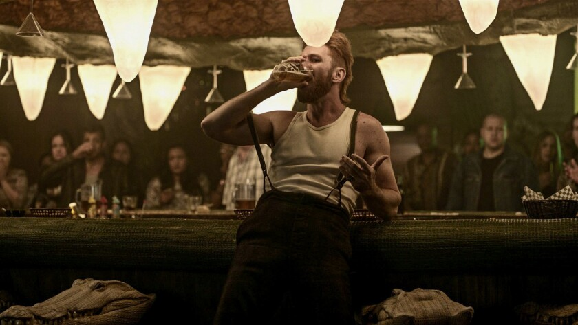 """Pablo Schreiber as old god Mad Sweeney at Jack's Crocodile Bar in """"American Gods."""""""