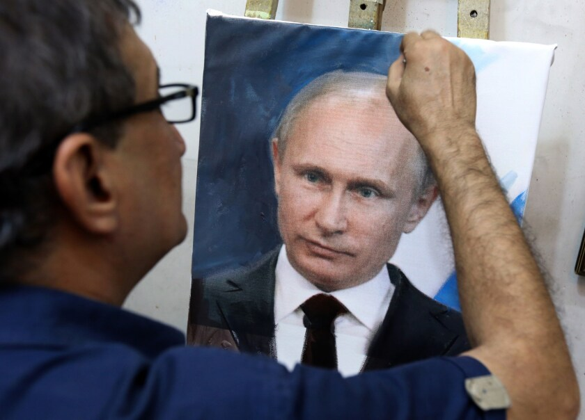 An Iraqi artist touches up a painting of Vladimir Putin in his studio in Baghdad on Oct. 7. Putin's popularity has soared in Iraq since Russia joined the fray in Syria with an aerial campaign and dispatched intelligence officials to Baghdad.