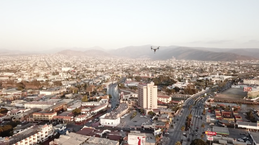 A drone hovers above Ensenada, in northern Mexico, where the local police department says drones have helped them make 500 arrests and reduce crime by 10 percent.