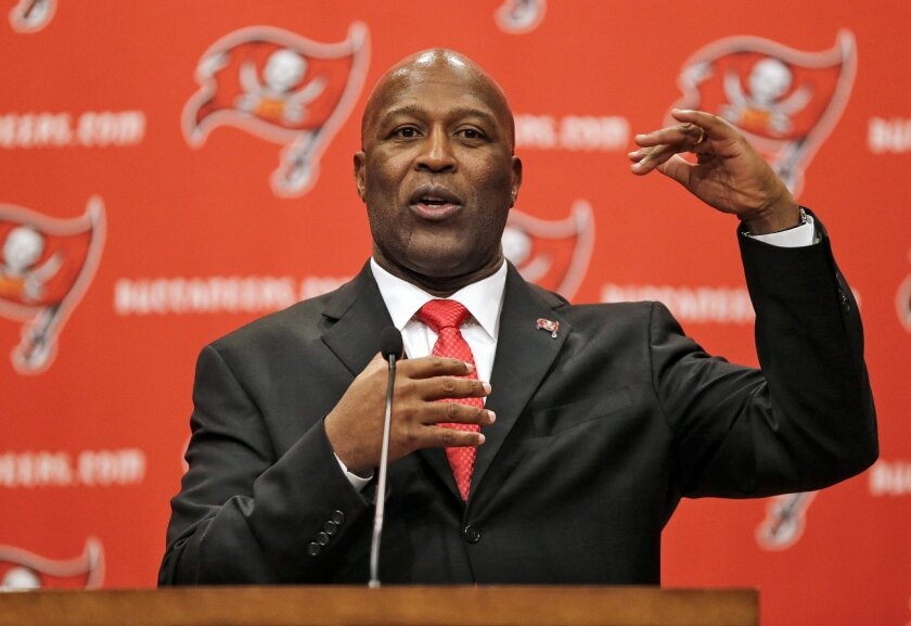 Tampa Bay Buccaneers new head coach Lovie Smith gestures during an NFL news conference Monday, Jan. 6, 2014, in Tampa, Fla. Smith replaces Greg Schiano, who was fired after the season ended. Smith is the former defensive coordinator for Tampa Bay, who was fired by Chicago as head coach last year. (AP Photo/Chris O'Meara)