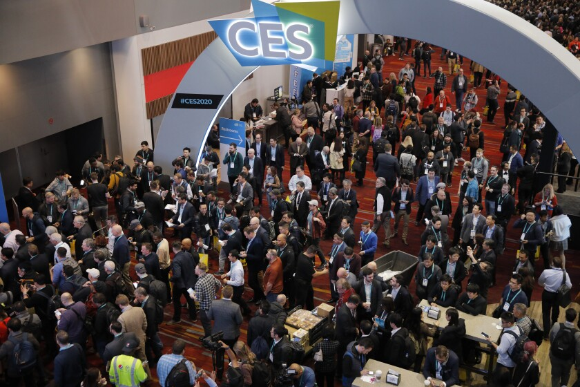 """FILE - In this Jan. 7, 2020 file photo, crowds enter the convention center on the first day of the CES tech show, in Las Vegas. Every January, huge crowds descend on Las Vegas for the CES gadget show, an extravaganza of tech and glitz intended to set the tone for the coming year in consumer technology. CES kicks off this week, but thanks to the pandemic, it will be in a radical new format — a """"virtual"""" show taking place only in cyberspace. (AP Photo/John Locher, File)"""