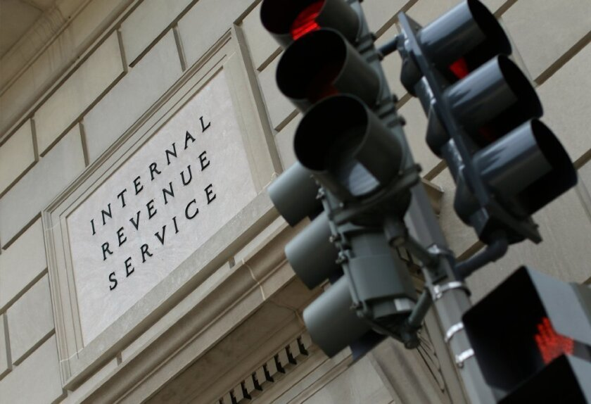 Erratic enforcement by the IRS has led to calls for Congress to end the federal restriction on tax-exempt churches from endorsing political candidates. Above, the IRS building in Washington.