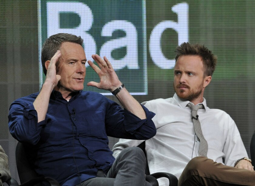 """FILE - In this July 26, 2013 file photo, Bryan Cranston, left, and Aaron Paul, cast members in """"Breaking Bad,"""" take part in a panel discussion during AMC's Summer 2013 TCA press tour in Beverly Hills, Calif. A University of New Mexico School of Law student journal has published a special issue analyzing legal issues related to the story line of AMC-TV's """"Breaking Bad."""" An edition of the New Mexico Law Review released this week looks at the war on drugs, the hypothetical arrest of Walter White, and questionable practices of defense lawyer Saul Goodman.Editor Matthew Zidovsky says students wanted to use the fictional hit television series to discuss serious legal issues like the Fourth Amendment and professional lawyer ethics. (Photo by Chris Pizzello/Invision/AP, File)"""