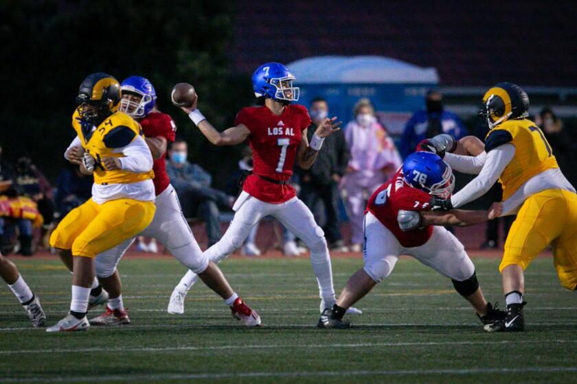 Los Alamitos quarterback Malachi Nelson throws the football against Long Beach Millikan.