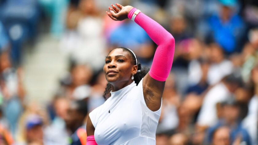 Serena Williams raises his arm after defeating Johanna Larsson of Sweden, 6-2, 6-1, at the U.S. Open.