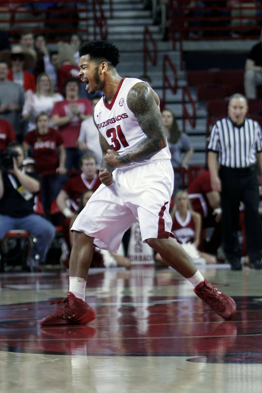 Arkansas' Anton Beard (31) reacts to winning possession of the ball during the first half of an NCAA college basketball game against Auburn, Wednesday, Feb. 17, 2016, in Fayetteville, Ark. (AP Photo/Samantha Baker)