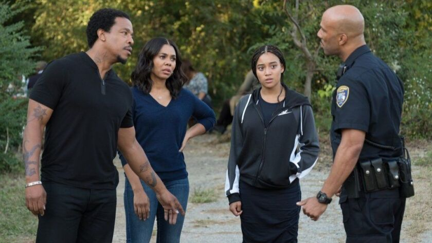 """Russell Hornsby, Regina Hall, Amandla Stenberg and Common in """"The Hate U Give."""""""