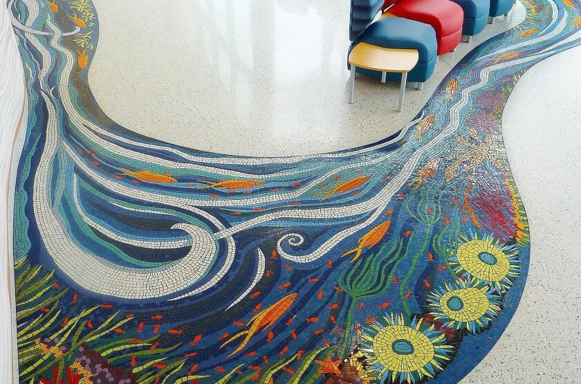 "Kim Emerson's ""River of Life"" mosaic moves through the main lobby of Rady Children's Hospital, under a glass wall, and into a garden."