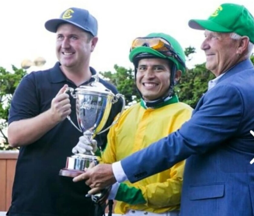 From left, Nick Gatto, jockey Mario Gutierrez and Dan Gatto celebrate the victory of Point Piper in the 2016 Longacres Mile at Emerald Downs.