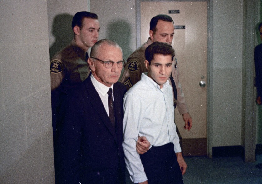 Sirhan Sirhan, right, in June 1968 with attorney Russell E. Parsons in Los Angeles.