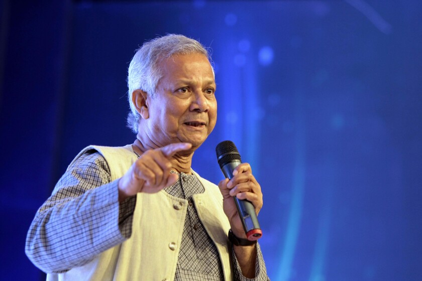FILE- In this June 28, 2013 file photo, Bangladeshi Nobel Laureate Muhammad Yunus, the founder of Grameen Bank speaks on the 4th annual Social Business Day in Dhaka, Bangladesh. A court in Bangladesh's capital Sunday granted bail to micro-credit pioneer and Nobel laureate Muhammad Yunus over the firing of three employees by Grameen Communications, where he is chairman. (AP Photo/ A.M.Ahad, File)