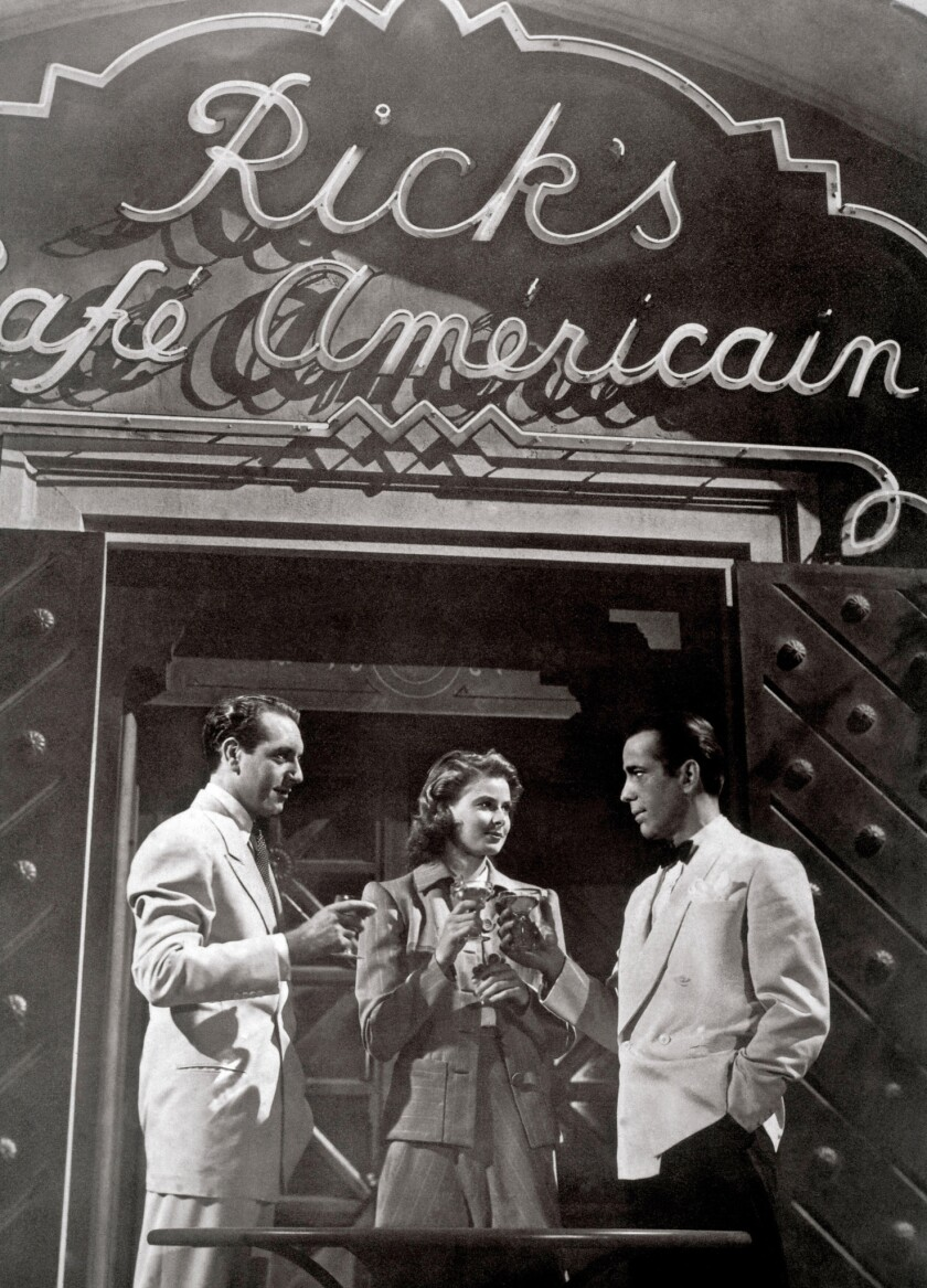Cocktail in Rick's Cafe Americain: PAUL HENREID, INGRID BERGMAN, HUMPHREY BOGART Regie: Michael Curtiz. Image shot 1942. Exact date unknown.
