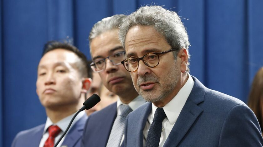 Assemblyman Richard Bloom (D-Santa Monica), right, discusses his plan to amend state law to allow cities and counties to impose rent control on homes more than 10 years old.
