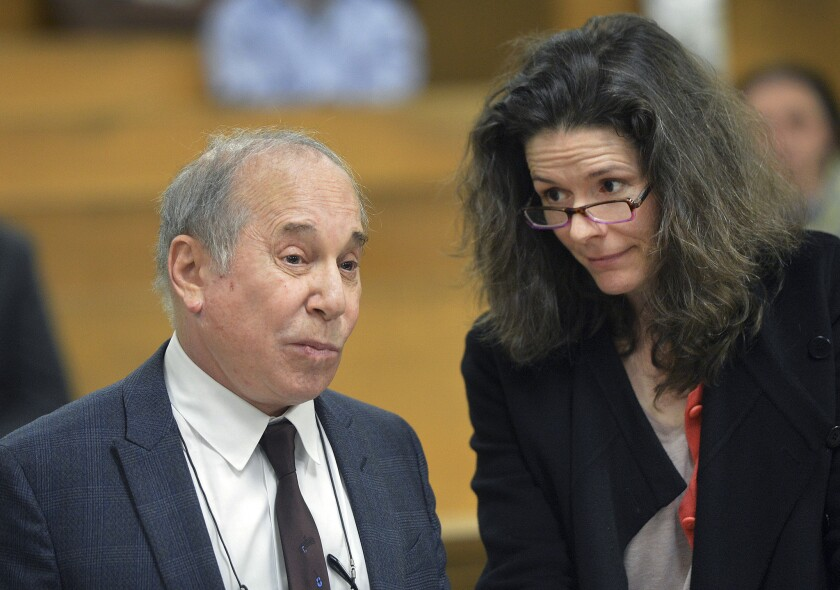 Paul Simon and wife Edie Brickell appear at a hearing in Norwalk, Conn., last week after they were arrested and charged with disorderly conduct. Simon played his first public concert since the incident on Wednesday in New York.