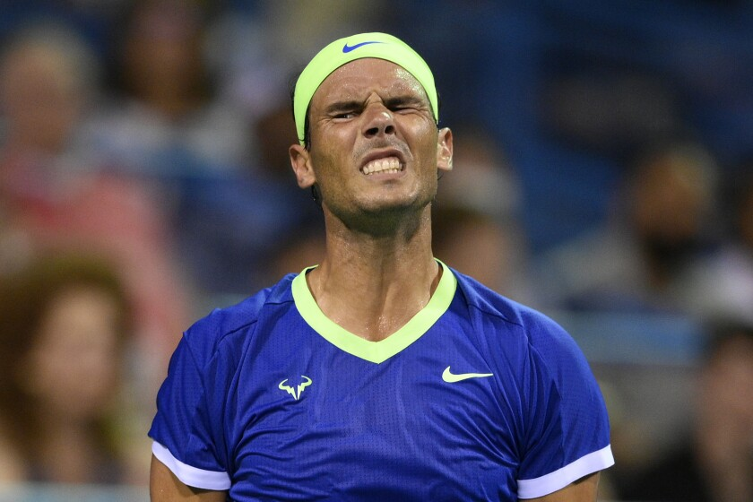 Rafael Nadal, of Spain, reacts during a match against Lloyd Harris, of South Africa, at the Citi Open tennis tournament Thursday, Aug. 5, 2021, in Washington. Harris won 6-4, 1-6, 6-4. (AP Photo/Nick Wass)