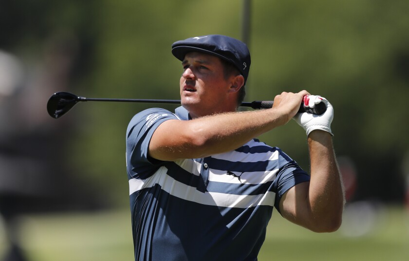 Bryson DeChambeau drives on the second tee during the final round of the Rocket Mortgage Classic.