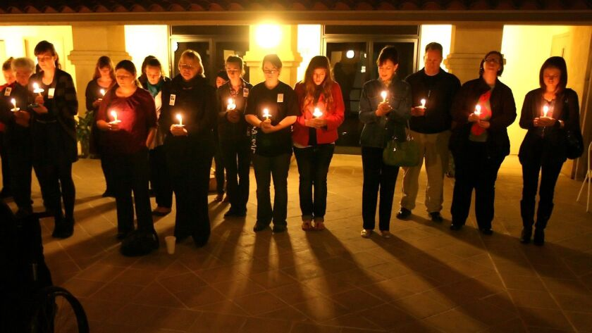 Students and activists participate in candlelight vigil for victims of human trafficking worldwide,