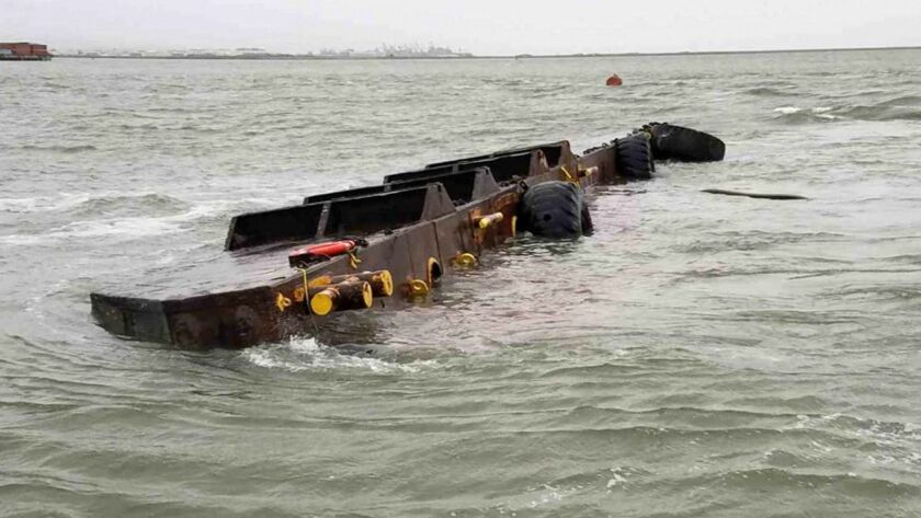 After capsizing, the 112-foot freight barge Vengeance is leaking diesel fuel and hydraulic oil into the San Francisco Bay.