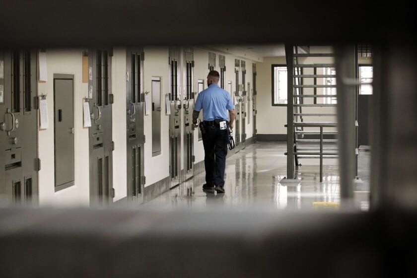 A guard patrols the Adelanto detention facility.
